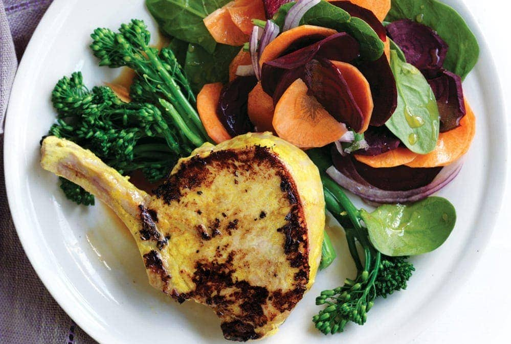 Turmeric pork with beetroot and carrot salad