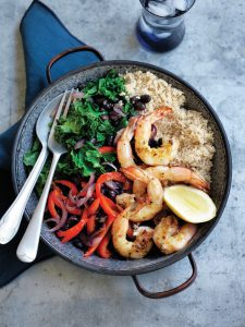 Warm black bean and kale couscous with grilled prawns