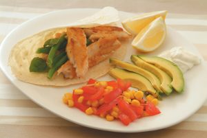 White and green bean tortillas with crispy fish and corn and tomato salsa