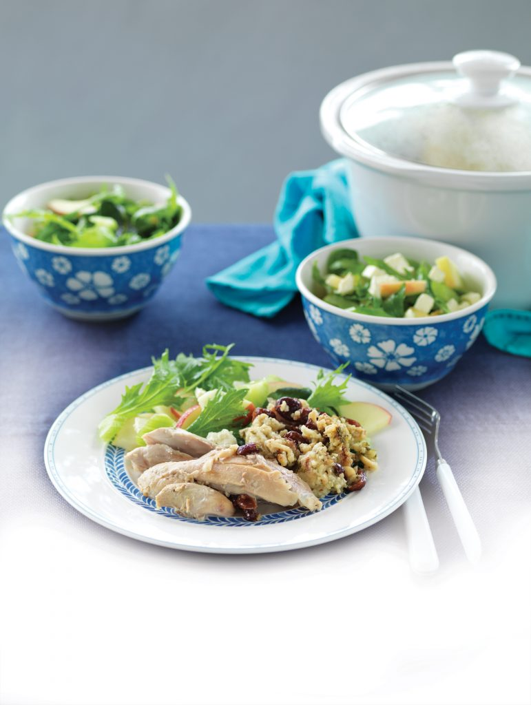Whole slow-cooked chicken stuffed with cranberry and almond couscous