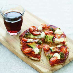 Wholemeal pizzas with ham, courgette and ricotta