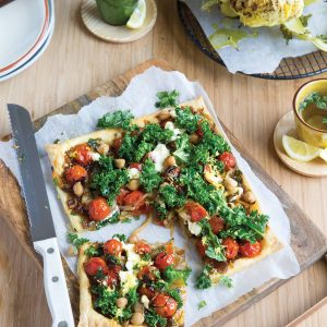 Roasted whole cauliflower with tomato, fennel and chickpea galette