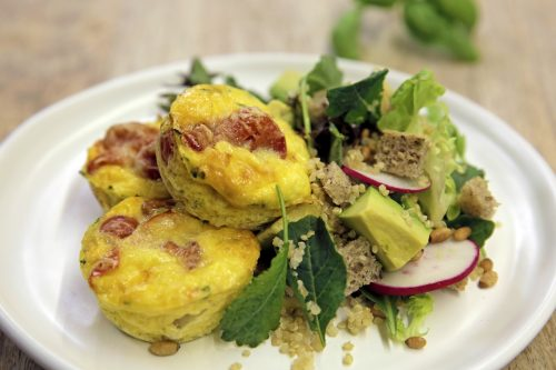 Courgette and tomato frittatas with avocado, quinoa and radish salad