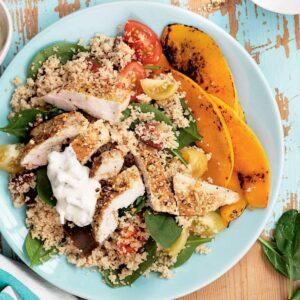 Dukkah chicken with warm couscous salad and tzatziki