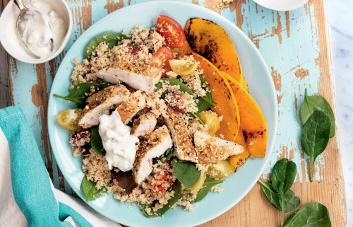 Dukkah chicken with warm couscous salad and tzatziki