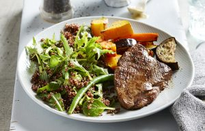Low-FODMAP seared steak with maple mustard sauce and quinoa salad
