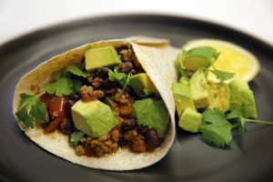 Mexican black beans with spicy avocado and grilled tortilla