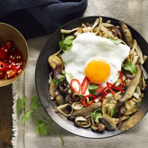 Mushroom noodle stir-fry with fried egg