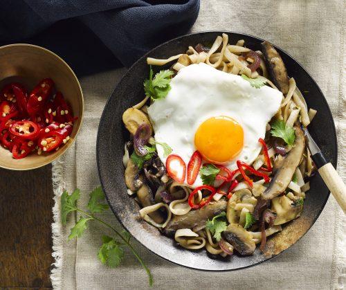 Mushroom noodle stir-fry with fried egg