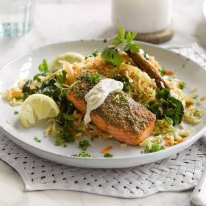 Nut and seed-crusted salmon with brown rice pilaf