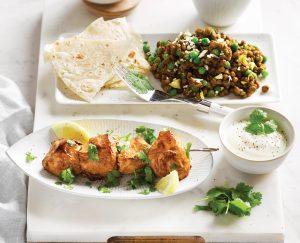 Tandoori chicken skewers with lentil, green pea and cauliflower dhal