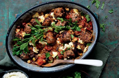 Baked meatballs with tomato, olives and ricotta