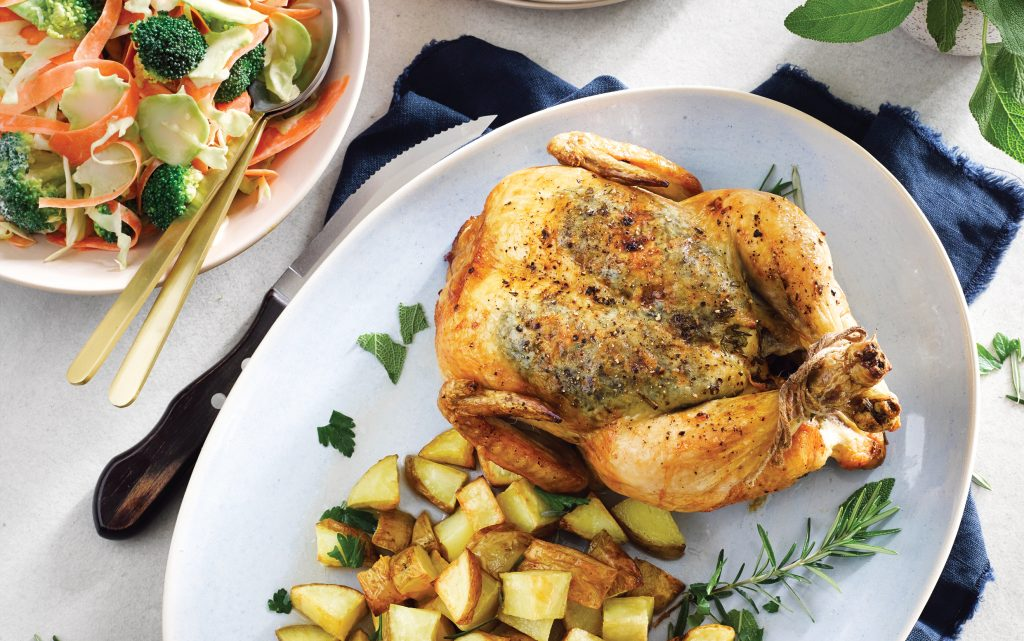 Roast herb chicken and potatoes with tangy kohlrabi slaw