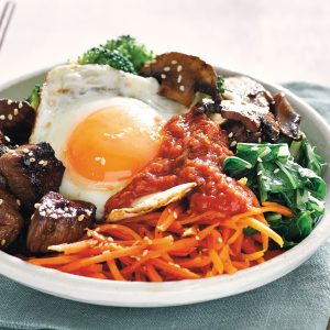 Bibimbap with grilled lamb and kimchi ketchup