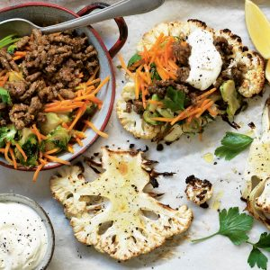 Cauliflower 'steaks' with Moroccan-spiced lamb