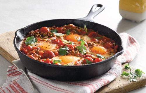 Mexican baked eggs with tomatoes and lentils