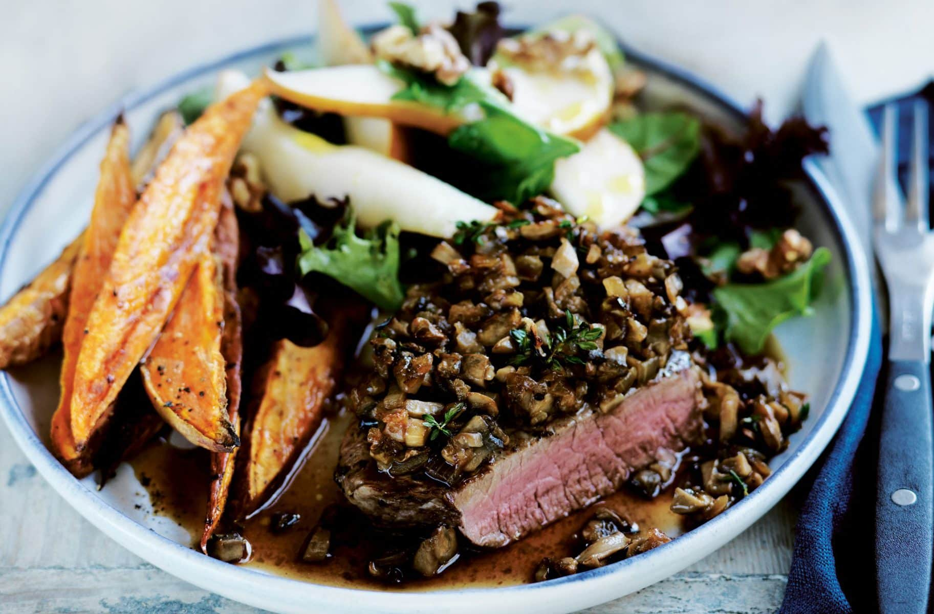 Mushroom and thyme-crusted beef with pear salad