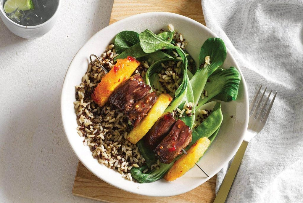 Sticky lamb kebabs with greens