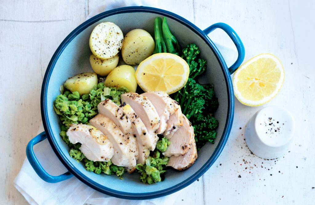 Garlicky roast chicken with mashed lemon peas