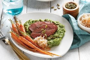 Lamb with broad bean purée and roasted baby carrots