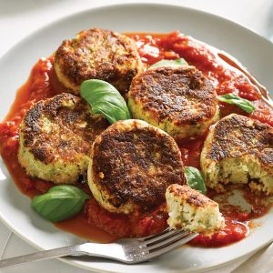 White bean, cauli and courgette patties with spicy tomato and basil sauce