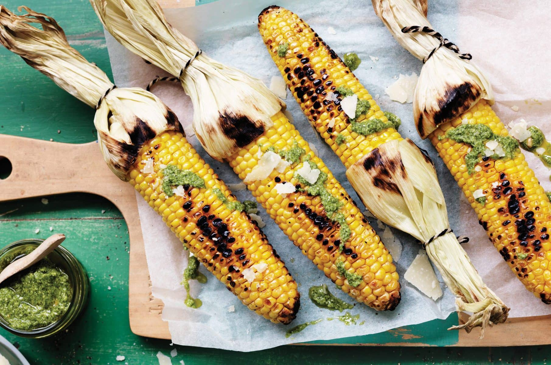 Grilled corn with pesto and parmesan