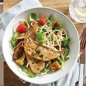 Pork schnitzel with roasted tomato pasta