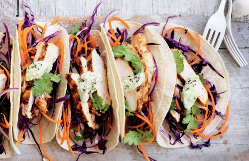 Spicy chicken tacos with slaw and avocado dressing