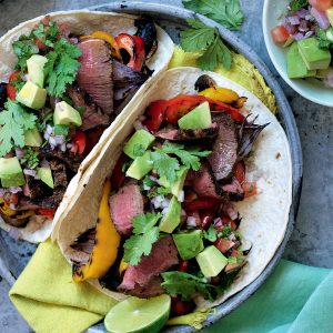 Smoky beef and vege fajitas with avocado salsa