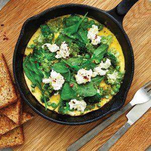 Spinach, broccoli and pesto open omelette with lemon ricotta