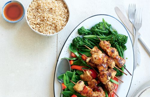 Chicken skewers with stir-fried greens