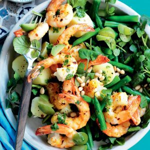 Prawns with green olives, lemon, pine nuts and watercress