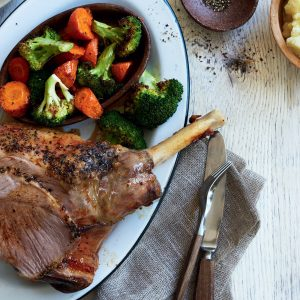 Roast lamb dinner with skordalia
