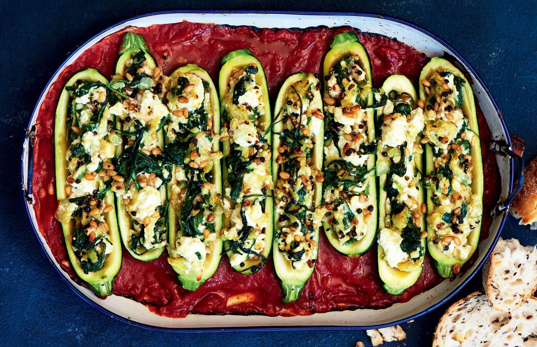 Spinach, pine nut and ricotta stuffed courgette bake