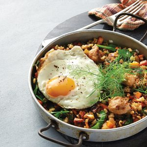 Vegetable and sausage pilaf with egg