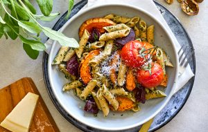 Pasta with walnut-sage pesto and roast vegetables