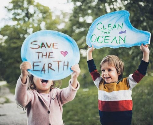 Children with climate change signs