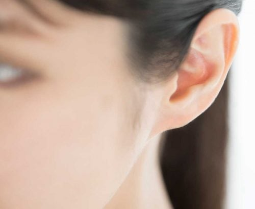 Asian woman's ear - hearing