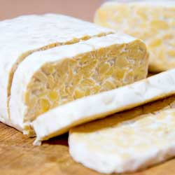 block of tempeh sliced