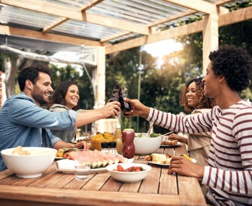 Friends eating outside, toasting