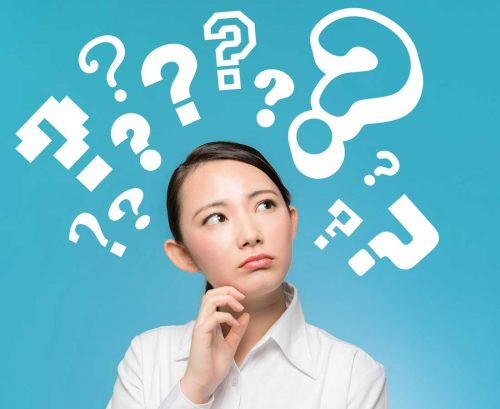 Asian woman with question marks above her head