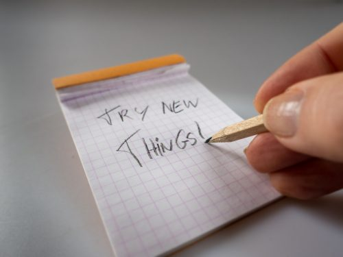 Person writing try new things