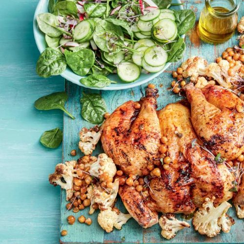 Harissa-spiced chicken with roasted cauliflower and chickpeas
