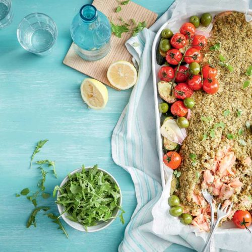 Pesto-crusted salmon with tomatoes and olives