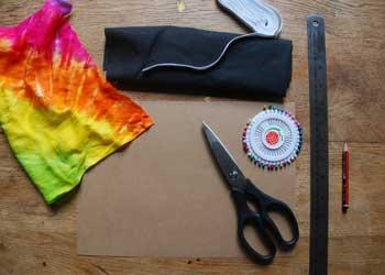 cloth, scissors, paper, ruler, pins, elastic, pencil
