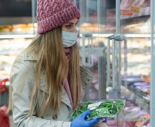 Woman shopping with gloves and mask on