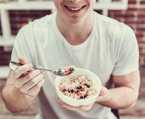 Man eating bowel-friendly oatmeal