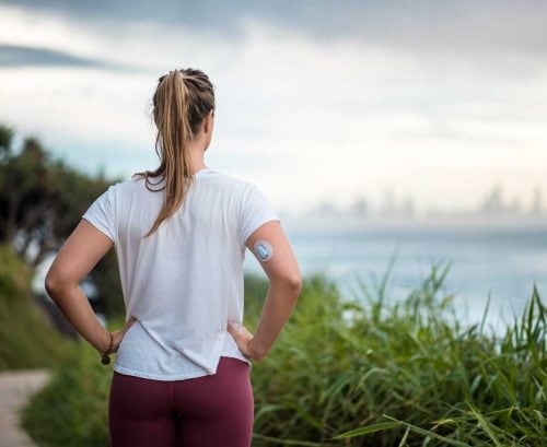 Woman with diabetes looking at view of city across water