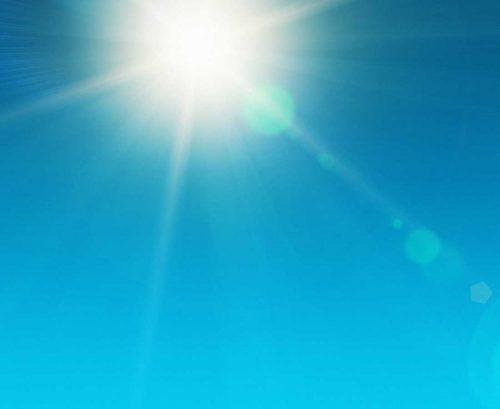 Sun shining in a blue sky