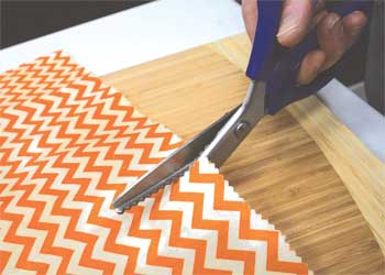 Cutting fabric with scissors